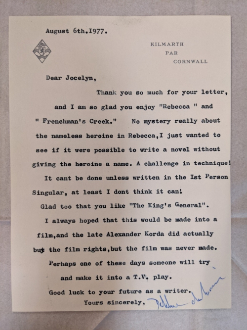 Photograph of typescript letter from Daphne du Maurier to a fan explaining the lack of name attribution for a character in her novel, Rebecca.