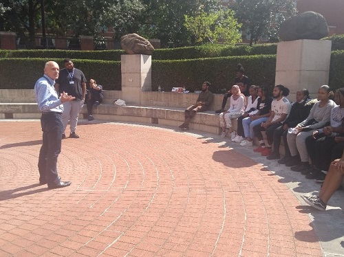A man speaking outside the British Library