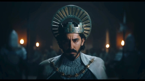 A still from the Green Knight movie, showing Dev Patel wearing a crown