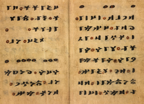 Double-page spread of text in Old Turkic script in black and red ink