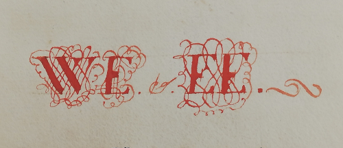 The initials 'W. E.' and 'E. E.' drawn in and decorated with penwork in red ink