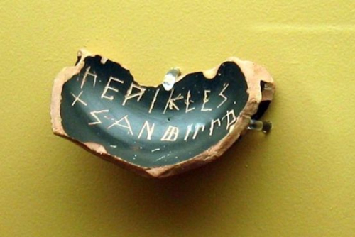Piece of a dark pottery dish inscribed with the name of Pericles