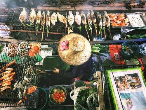 Street Food market selling grilled foods