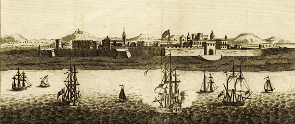 View of a Fort St George Madras from the sea, with a church to the left, hill peaks behind and ships in the foreground, including one firing guns.