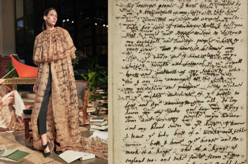 A woman wearing a garment based on a manuscript.