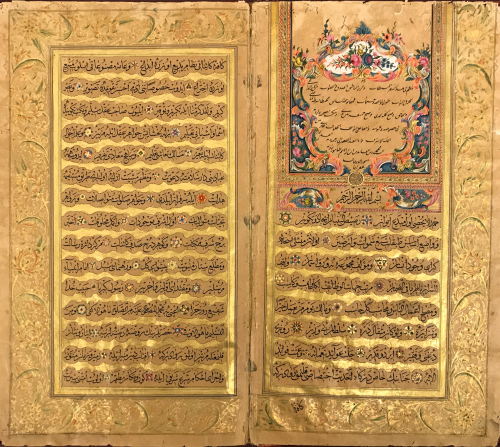 Two page spread of manuscript in Arabic script with gold bands between text and gold margin lines. Top right hand corner features floral illumination in red, green, blue, black, white, pink and purple inks as well as gold.
