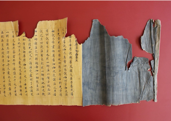 Recto before treatment showing a torn scroll with Lotus Sutra characters