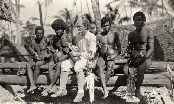 Malinowski seated with a group of men holding lime pots. Image courtesy of LSE Library: MALINOWSKI/3/18/2