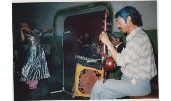 A dancer and singer accompanied by musicians