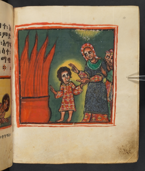 Image of child speaking to adult woman with people behind her in front of large fire, in full colour, outlined by red frame