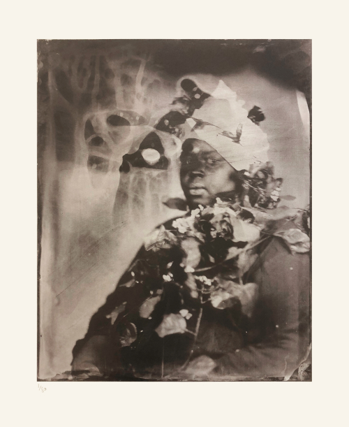 Khadija Saye, facing the camera, with the blurry outlines of plastic flowers found her neck
