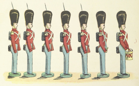 Toy British soldiers dressed in red uniforms standing in a line