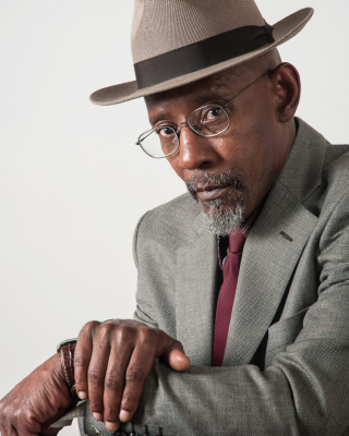 Portrait of Linton Kwesi Johnson, seated