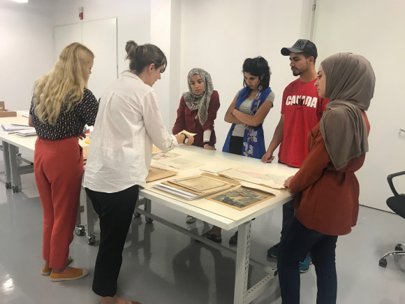 Picture 6: Assessment of items prior to digitisation with Bara and the three volunteers
