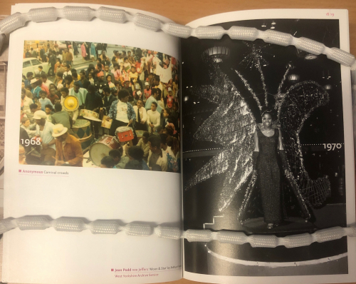 Open book with a photograph of a carnival crowd in 1968 and a woman dressed in a costume from 1970