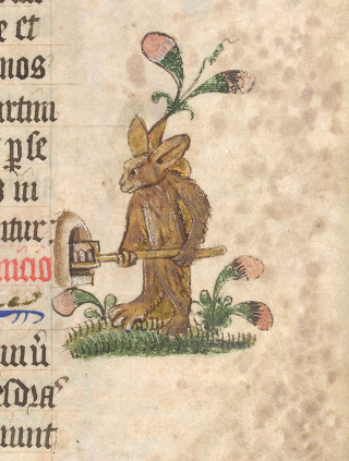 A rabbit pushes a tray of baked goods into an oven