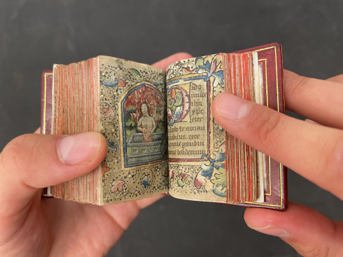 Miniature Book of Hours held open on an illuminated page