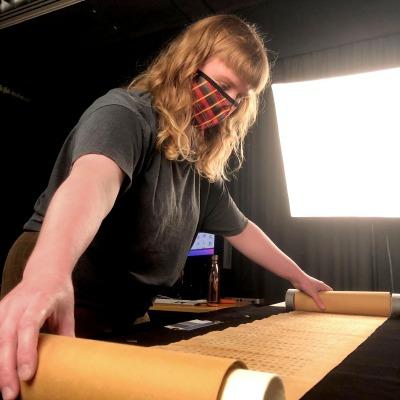 Isabelle unfurling the scrolls
