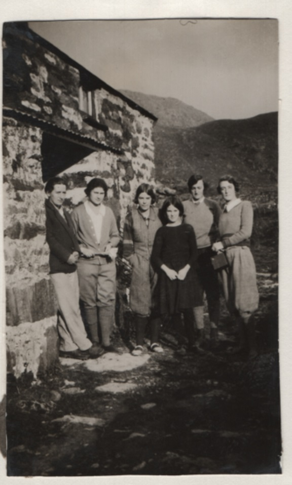 A black and white photo of six women standing outside a Welsh cottage