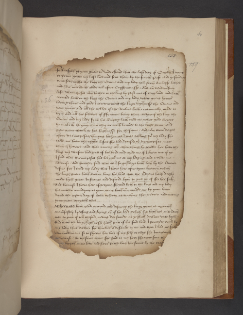 A manuscript page containing a letter in English from Sir Thomas Boleyn to Cardinal Wolsey. The edges of the paper page have been burned and remounted in paper frames.