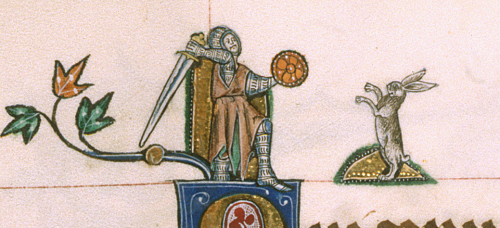 A knight swings his sword at a rabbit which rears up on its hind legs