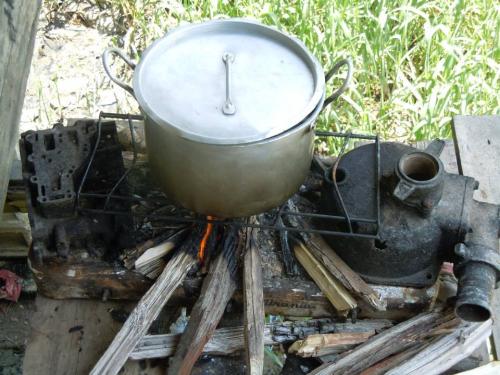 Silver pot on an open fire