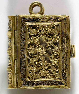 Girdle book shown closed with gold filigree cover