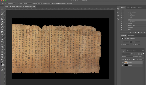 Gray frame of a computer application with coloured icons around an image of a yellowed scroll with Chinese characters on it with a black background