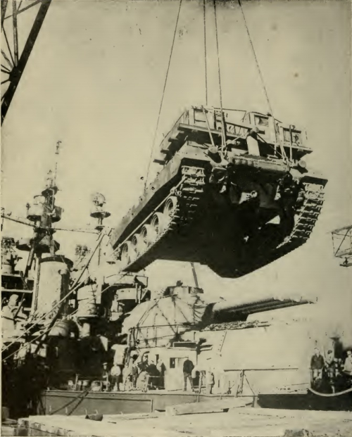 A tank is hoisted in the air.