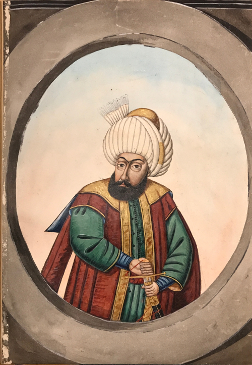 Painting of a middle-aged man with a dark beard in a white turban, topped with gold band, and wearing a red, gold, and green robe, holding the hilt of his sword, inside of a grey oval frame