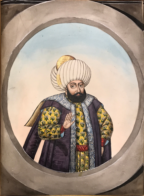 Painting of a middle-aged man with dark beard in yellow kaftan with red belt and dark blue vest, wearing a large white turban. The man is raising his right hand