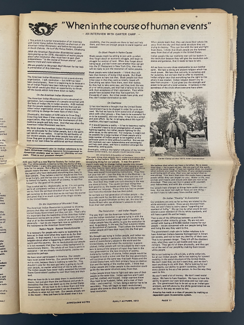 A page of a magazine with three columns of text and a small black and white picture in the final right hand column of a man on a horse.