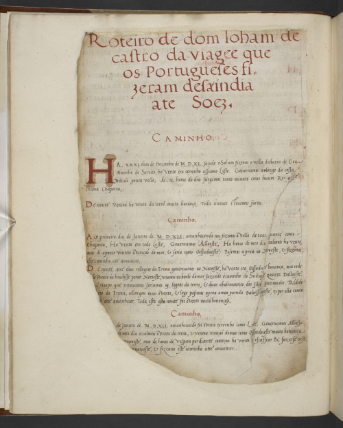 The title page of the Roteiro do Mar Roxo, with headings and initials in red ink, partially damaged by fire.