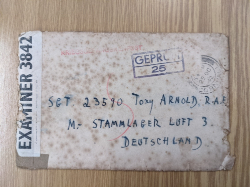 Photograph of an envelope showing passage through censors