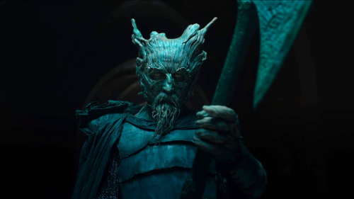 A still from the Green Knight movie, showing the character of the Green Knight