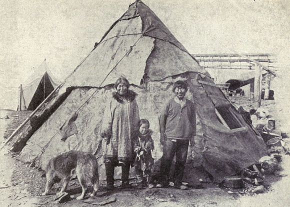 Inuit family with Malamute