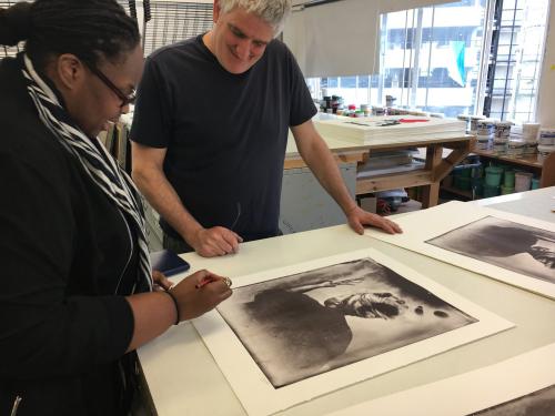 Khadija Saye working on silkscreen prints of 'Sothiou' with Matthew Rich, 2017