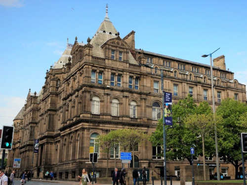 Photograph of Leeds Central Library on a clear sunny day