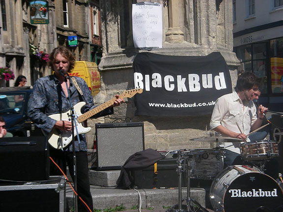 Blackbud performing live outdoors in Glastonbury town